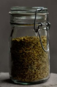 A glass jar filled with fennel seeds